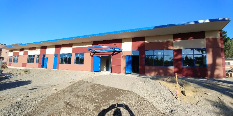 School building during landscaping work